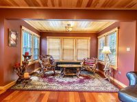 Sitting Area With Two Chairs, Coffee Table & Large Windows