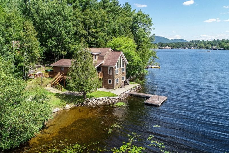Aerial Of Waterfront Home With Dock On Lake Flower