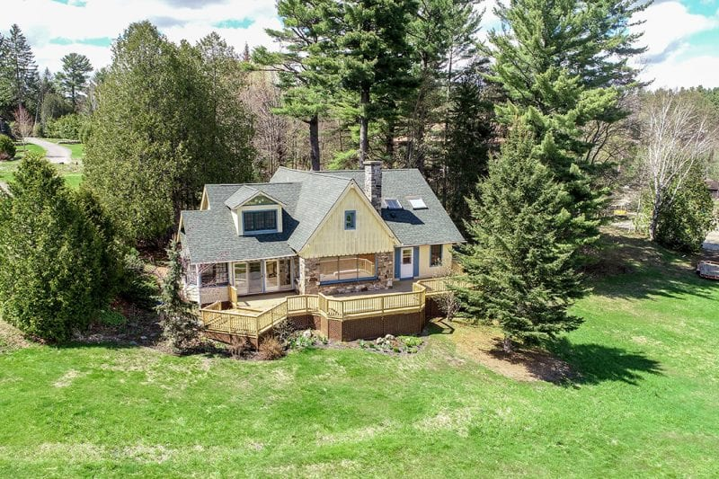 Aerial Of Yellow Lake Placid Club Cottage With Large Deck