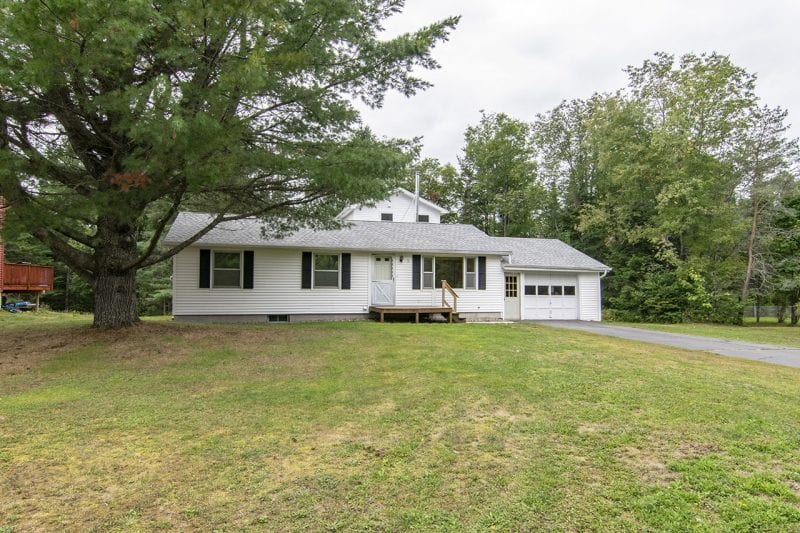 White Adirondack Raised Ranch With Yard