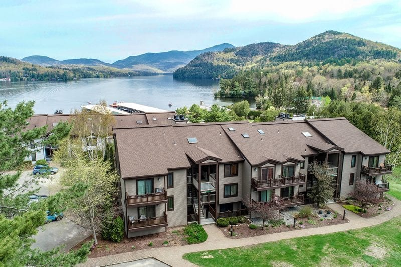 Aerial Of The Harbor Condo Units With Lake Placid & Mountains In The Background