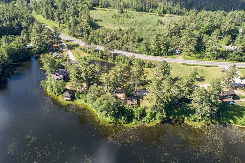 Aerial Of Property From Larger Pond