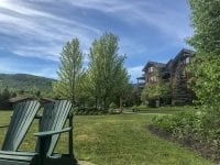 Exterior Of Whiteface Lodge With Two Chairs
