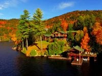 Aerial Of Lake Placid Great Camp With Boathouse, Cottage & Main House