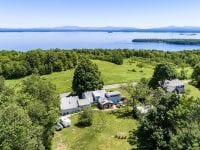 Aerial Of Farm House And Lake Champlain