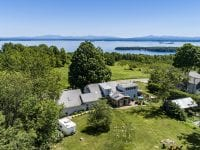 Aerial Of Farm House And Lake Champlain