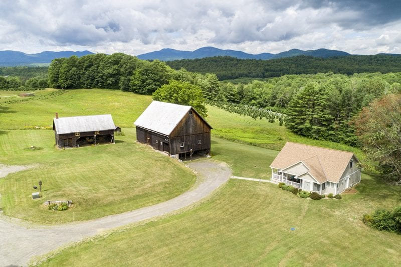 Aerial Of White House, Barns & Mountains