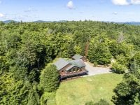 Aerial Of Adirondack Cottage With Large Deck