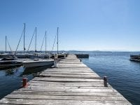 Dock With Boats and View Of The Lake