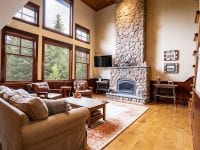 Living Room With Floor To Ceiling Fireplace & Couch