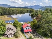 Aerial Of Blue Home With Red Roof Overlooking Lake Placid & Whiteface Mountain