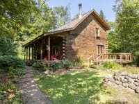 Log Home Exterior With Covered Porch