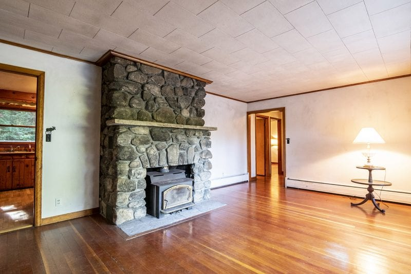 Living Room With Wood Stove and Hardwood Floors