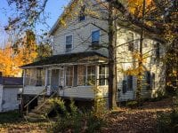 Exterior Of Yellow Home