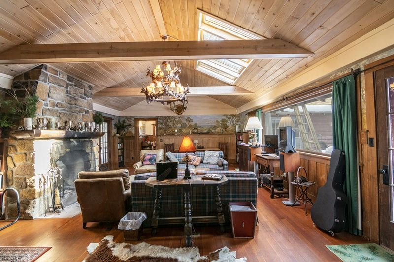 Great Room With Vaulted Ceiling, Wood Beam, Couches & Fireplace