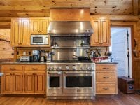 Kitchen With Large Stainless Stove