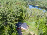 Aerial Of Ranch Style Home With Kurung Pond Behind
