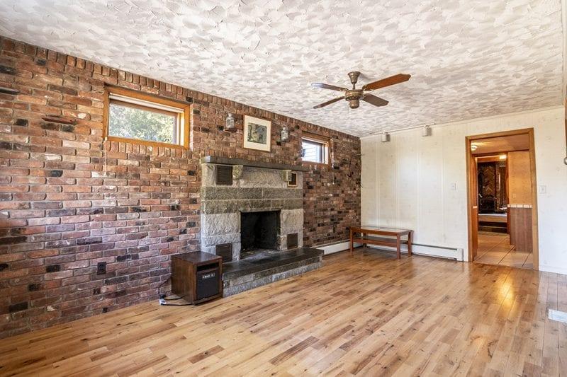 Living Room With Hardwood Floors & Fireplace